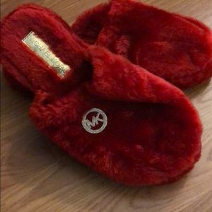 Red fuzzy Micheal Kors slippers